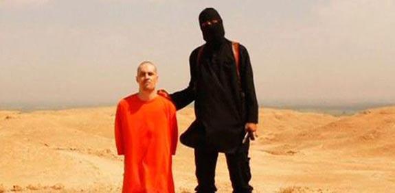 ההוצאה להורג של העיתונאי האמריקאי  ג'יימס פולי בידי דעאש / צילום: מסך